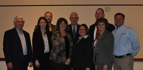 Nationwide Insurance staff members Cliff Short, Lyn Allison, Matt Hawk, Margie Chase, Chip Morris, Suzana Killilea, Brian Villec, Emily Keggan and Monty Carey pose after the DFB/ Nationwide Policyholder Dinner on Thursday, February 28.
